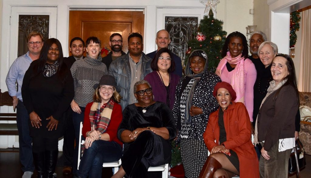 UNNC Board members celebrate the Holiday Season during the December Board meeting at the Winfandale House.